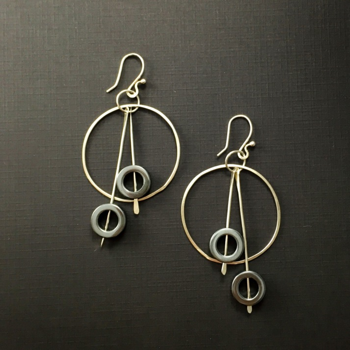 Asymmetric hematite dangled hoops