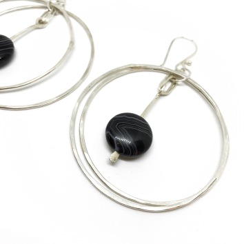 Banded black onyx in a silver hoop