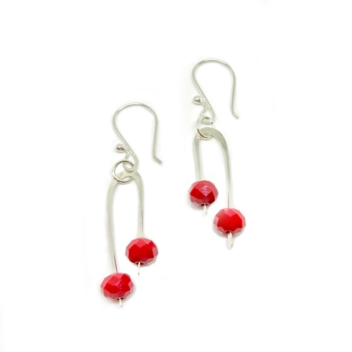 Balanced red glass dangles